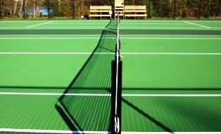 An image of the tennis courts at the Wenonah Outdoor Education Centre in Ontario.