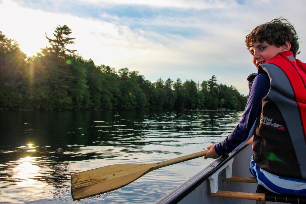 An image canoeing on Saw Lake at Wenonah in Muskoka Ontario Canada
