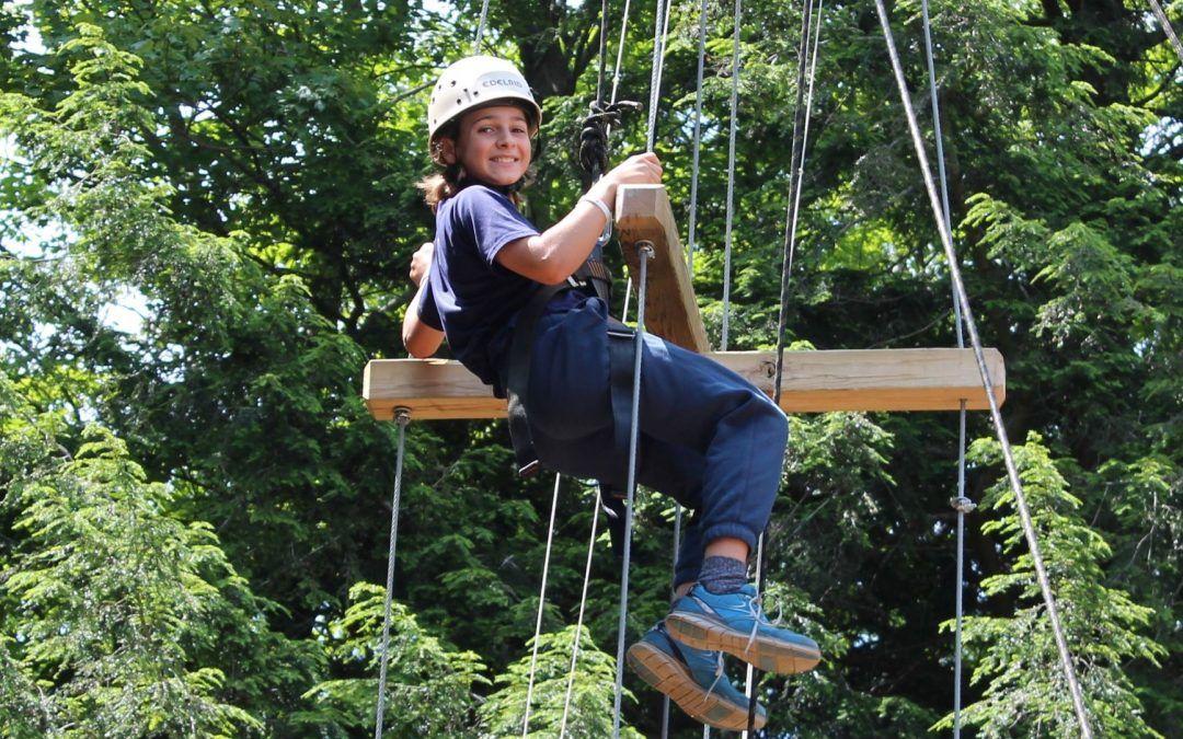 An image of a camper climbing at Camp Wenonah